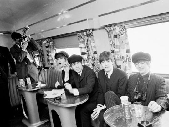 The boys banter with the press on Feb. 11, 1964, as