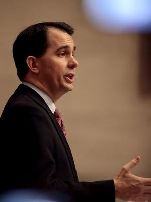Wisconsin Governor Scott Walker delivers his state budget address Tuesday at the state Capitol in Madison.