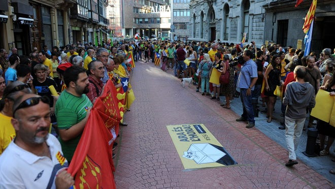 People take part in a demonstration in support of a Catalan vote on independence from Spain in the northern Spanish Basque city of Bilbao on Sept. 9.