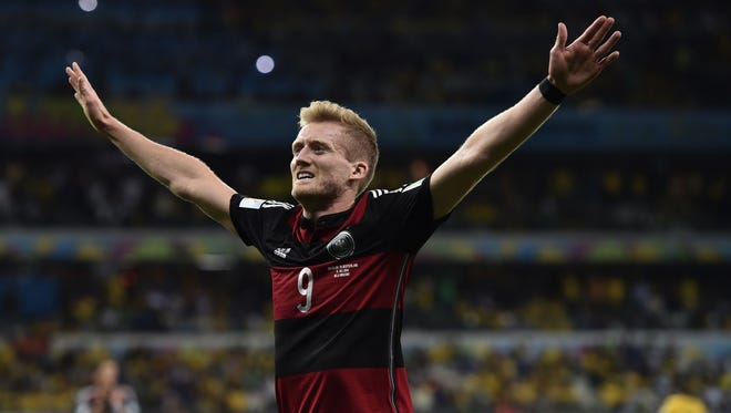Germany's Andre Schuerrle celebrates after scoring his side's seventh goal during the World Cup semifinal soccer match between Brazil and Germany at the Mineirao Stadium in Belo Horizonte, Brazil, Tuesday, July 8, 2014.