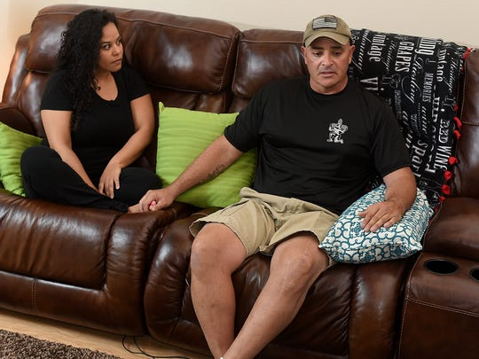 At right, David Montoya, a retired master sergeant with the New Mexico National Guard, talks on Thursday about support he has gotten from the community as his girlfriend, Summer Martinez, looks on.