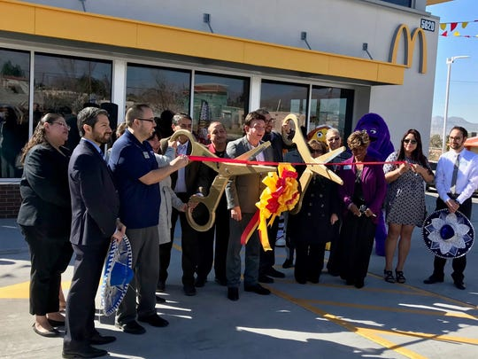 Richard Castro, center, holding ribbon, owner of  the newly remodeled McDonald's franchise at Montana Avenue and Trowbridge Drive, celebrates the location's reopening  with a ribbon-cutting ceremony Feb. 21.