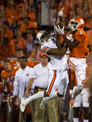 Clemson wide receiver Deon Cain (8) catches a pass over Auburn defensive back Carlton Davis (6) during the NCAA football game between Auburn and Clemson on Saturday, Sept. 9, 2017, in Clemson N.C.