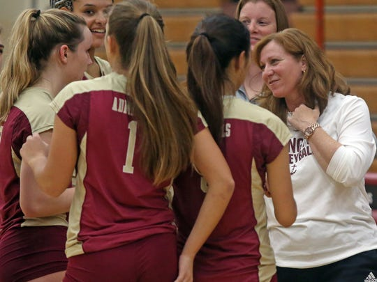 Arlington High School volleyball coach Maria Greenwood talks to her team during a match against Ketcham at Arlington in Freedom Plains on Monday.