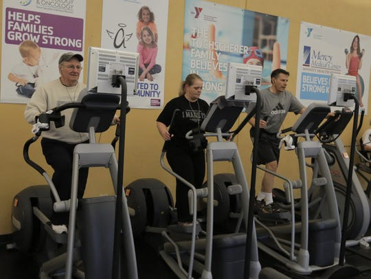 Members work out at the downtown YMCA on April 13.