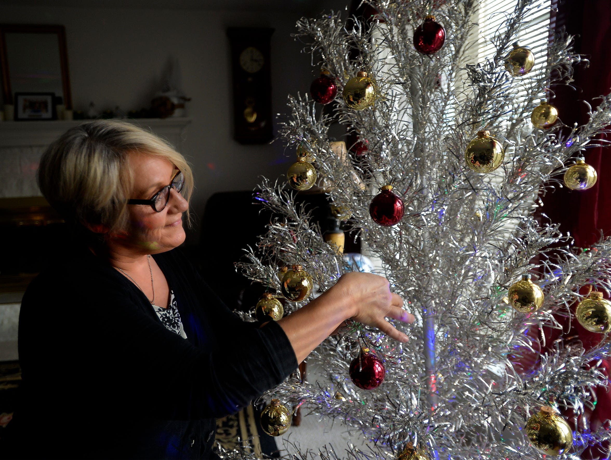 Rene Murray with her new vintage aluminum Christmas tree, which was an early Christmas gift from her daughter. It's been Rene's Christmas dream to have an aluminum tree since she first saw one at age 10.
