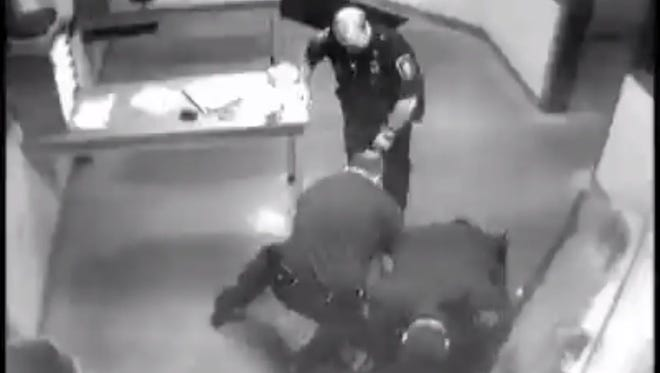 In this screen grab from a Genesse County (Mich.) jail video, law-enforcement officers are shown beating William Jennings of Flint Township, Mich., after a drunk-driving arrest on Sept. 18, 2010.