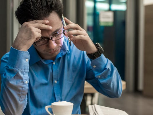 MSUFCU_Depressed businessman in the coffee shop. Stressed businessman