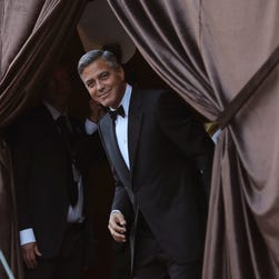 """This November 9, 2013 file photo shows US actor George Clooney as he attends the 2013 BAFTA LA Jaguar Britannia Awards presented by BBC America in Beverly Hills, California.  Film star George Clooney slammed the Hollywood movie industry for failing to stand up against the cyber threats that prompted Sony Pictures to cancel release of the movie """"The Interview."""" Clooney, one of the most influential figures in the US movie industry, said in an interview that fellow celebrities and industry figures declined to sign a petition he circulated in support of the satirical comedy, whose Christmas Day release has been scrapped. No one, the actor said, was brave enough to sign the petition, out of fear that doing so could make them vulnerable to a hacking attack like the one that befell Sony.""""It was a large number of people. It was sent to basically the heads of every place,"""" Clooney said in an interview published December 19, 2014 by the entertainment news website """"Deadline.""""To a person, the reply was """"'I can't sign this',"""" he said."""