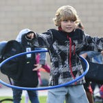 Porter Peed hula hoops at Laurel Elementary on Wednesday, October 7, 2015. The school set up activities outside so students who rode the bus could get some extra exercise on National Walk/Bike to School Day.