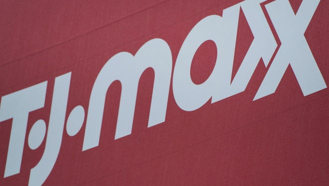 "This September 25, 2014 file photo shows a sign for TJ Maxx in Washington, DC.  Discount retailer TJX on February 25, 2015 announced it would raise minimum wages for its US workers, essentially matching an announcement last week from larger rival Wal-Mart Stores. The TJX Companies, which owns Marshall's, TJ Maxx and other discount apparel and home-goods chains, will hike wages of US staff to at least $9 an hour beginning in June and at least $10 per hour in 2016. ""This pay initiative is an important part of our strategies to continue attracting and retaining the best talent,"" said TJX chief executive Carol Meyrowitz."