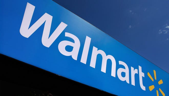 In this May 16, 2011 photo, the Wal-Mart logo is displayed in Springfield, Ill. What Wal-Mart Stores Inc. says about how it's reversing a slump in its namesake U.S. business will be at the front of analysts' minds at the company's annual meeting with Wall Street Wednesday, Oct. 12, 2011.