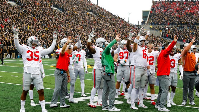 In this Nov. 4, 2017, photo, Ohio State players and coaches wave to children in the University of Iowa's children's hospital at the end of the first quarter of an NCAA college football game against Iowa in Iowa City, Iowa. In the new tradition, known as The Wave, at the end of the first quarter fans and players in the 70,585-seat Kinnick Stadium turn to wave to the pediatric patients watching from the hospital, a 12-story building that overlooks the stadium from across the street. (AP Photo/Charlie Neibergall)