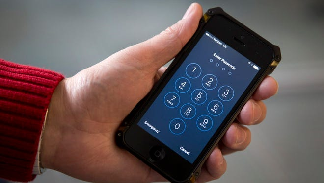 An iPhone is seen Feb. 16, 2017, in Washington. The government inspected a record number of international travelers' electronic devices in the last budget year. U.S. Customs and Border Protection announced Friday that it inspected 30,200 phones and other electronic devices in fiscal year 2017 _ a nearly 60 percent spike from 2016.