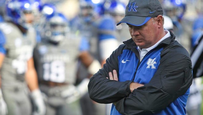 """Kentucky's Mark Stoops said of the Georgia loss: """"I'm not much on throwing things out, but I may have to throw this one out."""" The Wildcats have two more games, the last one against Louisville at Papa John's Cardinal Stadium. Nov. 8, 2014 By Matt Stone/The C-J"""