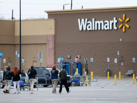 Walmart employees in Horseheads walk to re-enter the grocery store around 12:50 p.m. after a bomb threat was made shortly after 11 a.m. Nov. 28.