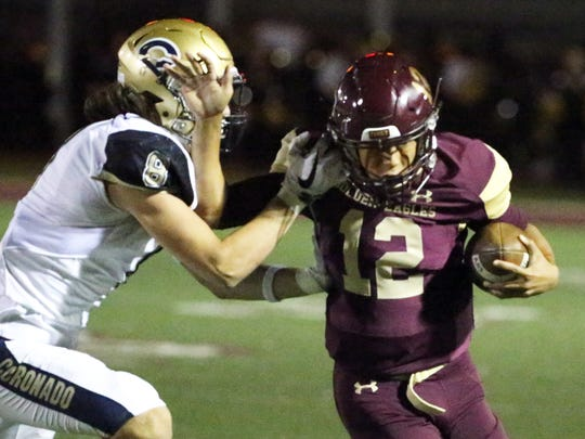 Andress quarterback Dominique Smith, 12, is pushed out of bounds by Carter Mcfadin, 8, of Coronado during a keeper play earlier this season at Andress.