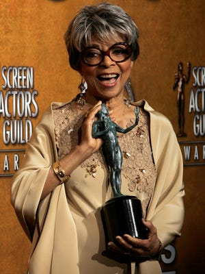 """In this Jan. 27, 2008 file photo, Ruby Dee poses with the award for outstanding performance by a female actor in a supporting role for her work in """"American Gangster"""" at the 14th Annual Screen Actors Guild Awards, in Los Angeles. Dee, an acclaimed actor and civil rights activist whose versatile career spanned stage, radio television and film, has died at age 91, according to her daughter. Nora Davis Day told The Associated Press on Thursday, June 12, 2014, that her mother died at home at New Rochelle, New York, on Wednesday night."""