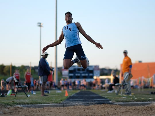 Hardin Valley's Willington Wright launches into a long jump during KIL track and field meet at Hardin Valley Academy on Monday, April 30, 2018.