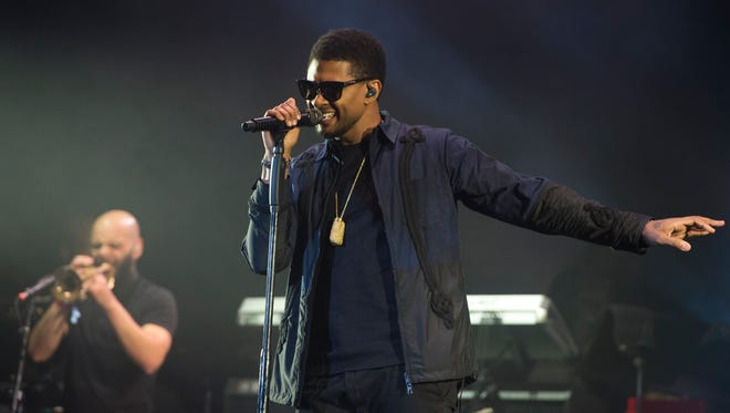 Usher & The Roots perform at the Okeechobee Music and Arts Festival on March 4, 2107.