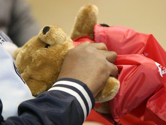 Greg Thaxton, Treasure's dad, packs a bear into a bag