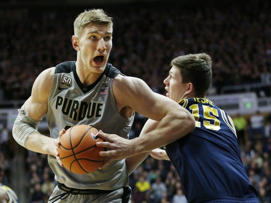 Isaac Haas of Purdue pivots for a shot against Jon