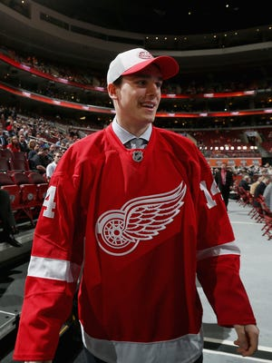 Dominic Turgeon walks to meet his team after being drafted by the Detroit Red Wings on Day 2 of the 2014 NHL Draft on June 28, 2014.