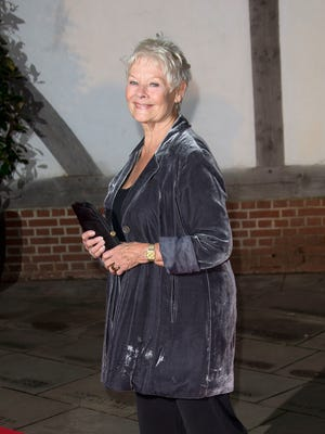 British actress Dame Judi Dench arrives at the Globe Theatre in central London on Oct. 17, 2013.