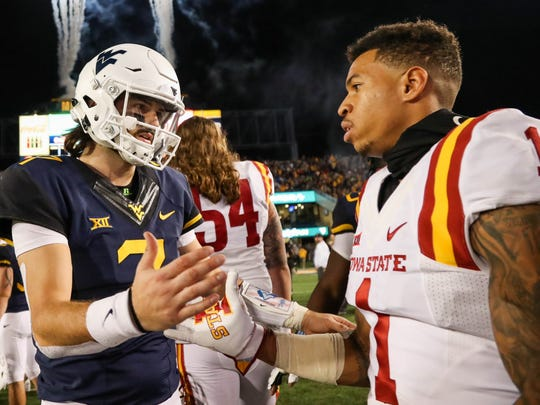 West Virginia Mountaineers quarterback Will Grier (7) talks with Iowa State Cyclones defensive back D'Andre Payne (1) after the game at Milan Puskar Stadium last season.
