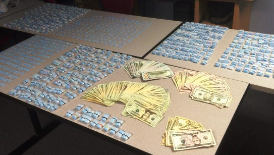 Police say they seized a record amount drugs and money.
