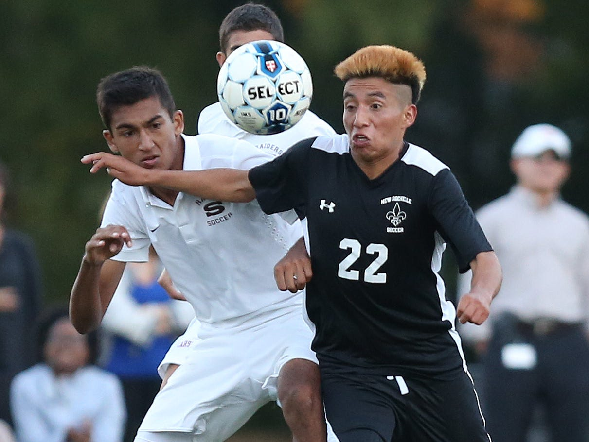 From left, Scarsdale's Fayez Merchant (17) and New Rochelle's Misael Jimenez (22) battle for ball control during a boys soccer game at Quaker Ridge School in Scrasdale Oct. 13, 2015. Scarsdale won the game 5-2.