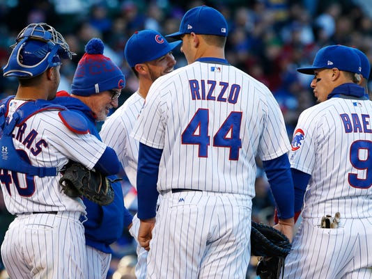 Chicago Cubs manager Joe Maddon, second from left, talks with players during the first inning of an interleague baseball game against the New York Yankees, Saturday, May 6, 2017, in Chicago. (AP Photo/Nam Y. Huh)
