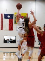 Brownwood's Sage Cupps (12) shoots one-handed over