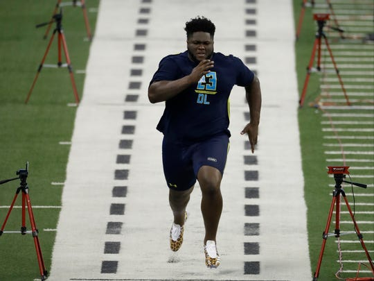 Mississippi defensive tackle D.J. Jones runs the 40-yard dash at the NFL Scouting Combine on Sunday.