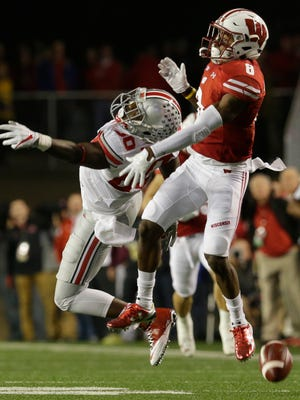 Wisconsin cornerback Sojourn Shelton defends a pass against Ohio State wide receiver Noah Brown.