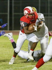 Manny Ridge running the ball in the middle. The Desert