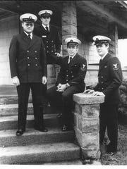 Vern Herrst (center) and his brothers on the steps