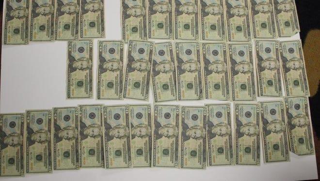 Counterfeit money found by Oxford Police.