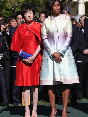 First lady Michelle Obama with Akie Abe, wife of Japanese Prime Minister Shinzo Abe, during welcome ceremony at the White House, April 28.
