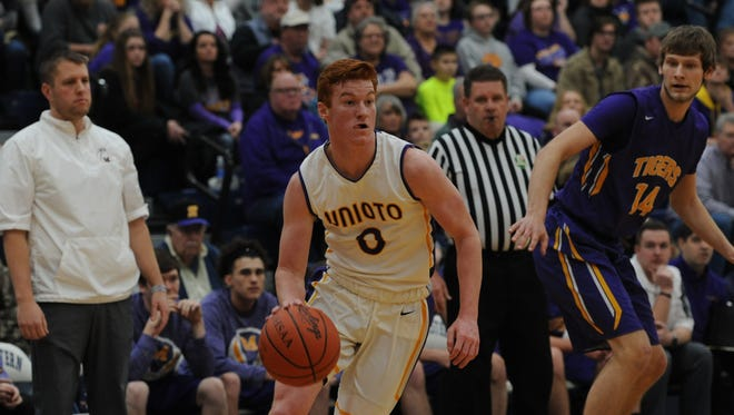 Unioto's Logan Swackhammer drives to the bucket Saturday afternoon at Southeastern High School in a Division II sectional final against McClain. The Shermans ousted the Tigers, 49-33.
