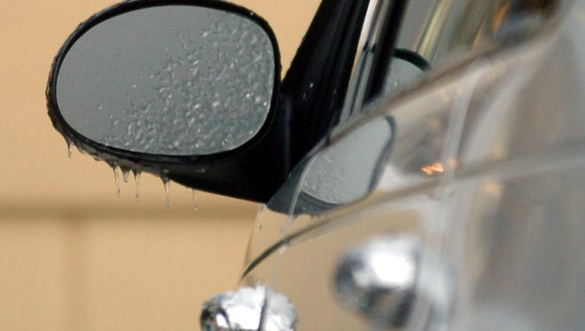 Ice hangs off of the side view mirror of a car in Carencro on Saturday morning. Claudia B. Laws / Dec. 25, 2004 IN PHOTOGS/CLAUDIA ICECC