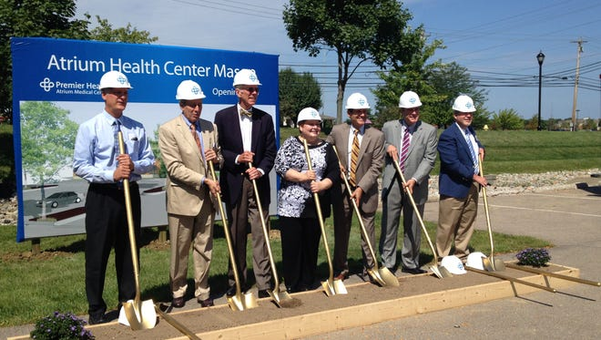 City officials join Premier Health representatives in breaking ground on an $11.5 million renovation project to bring the Atrium Health Center to Mason on Thursday, Aug. 28, 2014.