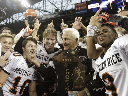 Birmingham Brother Rice coach Al Fracassa celebrates his final game and Division 2 title game win with his team on Nov. 29, 2013, at Ford Field.