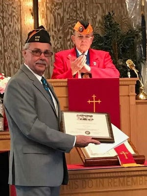 Buena Vista Township Committeeman John Armato receives the Four Chaplains Legion of Honor Humanitarian Award for his service to the community as Bob Swain applauds during a presentation on May 6 at the First Baptist Church in Richland.