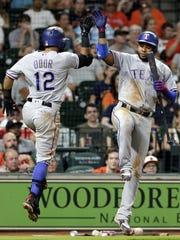 Texas Rangers' Rougned Odor (12) and Elvis Andrus celebrate