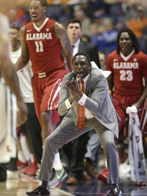 Alabama head coach Avery Johnson cheers on his team against Ole Miss in the SEC Tournament on Thursday.