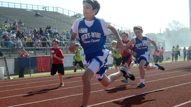 Ruby Wise Elementary School student Hunter Lavespere takes first in his heat in the 50-yard dash at the Rapides Parish Fitness Meet held Wednesday at Alexandria Senior High School.