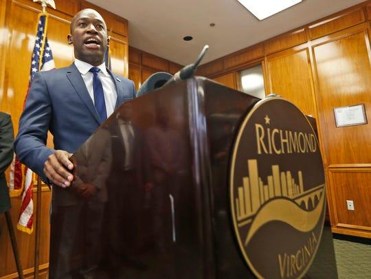 Richmond Mayor Levar Stoney gestures during a news