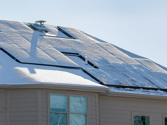 Solar panels ended up being approved for the less-sunny north side of Joey Myles' home.
