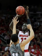 Louisville's Deng Adel knocks down a shot over Mississippi